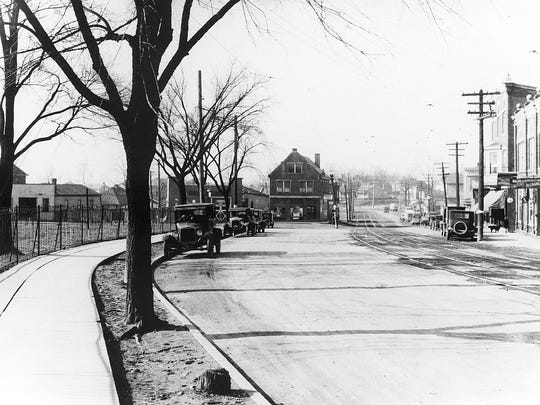 An early 1900s view from the sidewalk next to Fort Thomas' namesake fort shows the city's Midway District of businesses.