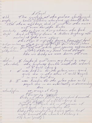In this image released Tuesday, May 6, 2014, by Sotheby's, an autographed manuscript signed by Bruce Springsteen is shown. The piece of lined paper is going on display Thursday, May 8, 2014, at Duke University. Floyd Bradley bought the lyrics at Sotheby's auction late last year and is letting Duke display them through the end of June.