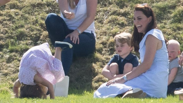 Duchess Kate laughs as Princess Charlotte attempts