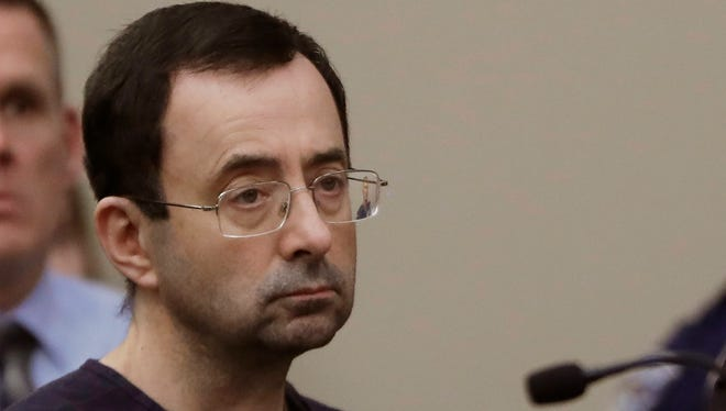 In this Jan. 24 photo, Larry Nassar sits during his sentencing hearing in Lansing, Mich.