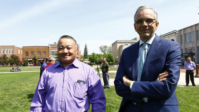 Marathon County Administrator Brad Karger, right, took part in a peace march inspiried by Dylan Yang's guilty verdict.