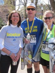 Erin Smith (right) with her parents, Eric and Susan