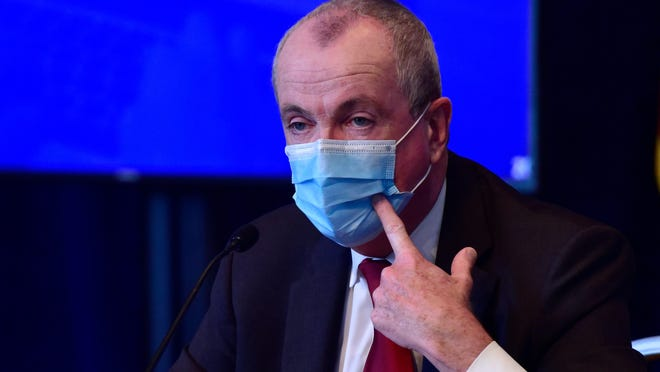 New Jersey Governor Phil Murphy encourages people to continue wearing face masks while in public during the Covid-19 daily news briefing at the War Memorial building in Trenton, N.J. on Friday June 19, 2020. Pool Photography by Tariq Zehawi/USA Today Network