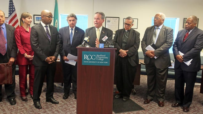 "Rockland County Executive Ed Day and religious leaders met with reporters after a private ""interfaith summit"" at Rockland Community College Wednesday. The meeting followed a string of incidents that highlighted the county's religious and cultural tensions."