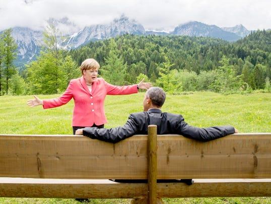 German Chancellor Angela Merkel speaks with U.S. President Barack Obama at Schloss Elmau hotel near Garmisch-Partenkirchen, Germany, Monday, June 8, 2015, during the G-7 summit.
