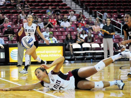 Jaime Guzman for the Sun-News   New Mexico State sophomore Jordan Abalos dives for a ball during the Aggies match against Oklahoma at the Pan American Center on Thursday as part of the Borderland Classic.