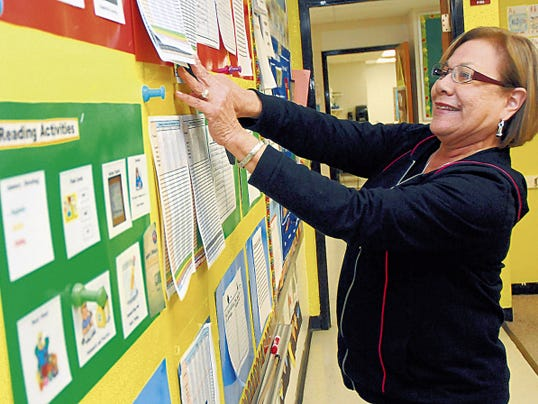 Sun-News file photo Second-grade teacher Margie Butler places activities on a bulletin board at Alameda Elementary earlier this year. Las Cruces Public Schools teachers earn a median salary of 46,877 — up from 45,388 last year.
