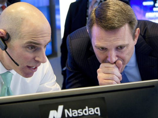 Jay Heller, IPO Execution Officer for Nasdaq, left, shows Keith Dunleavy, CEO of Inovalon, the progress of pricing for his company's stock on computer screens during the Bowie, Maryland health-tech firm's IPO in February at the Nasdaq MarketSite in New York.