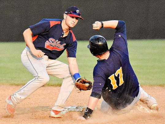Shiloh's Brock Gladfelter, left, tags out Mount Wolf's Steve Pokopec, right, at second during Central League baseball action in Mount Wolf, Pa. on Tuesday, July 21, 2015.