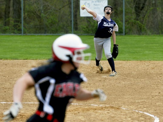 West York's Jossalin Shipley throws the ball to first to retire Dover's Taylor Lamparter in the second inning Friday at Dover. Dover defeated West York, 10-3.