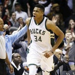 Giannis Antetokounmpo reacts after making a three-point shot during overtime Jan. 15 against the Hawks. Antetokounmpo says he was going to work hard on his shot.