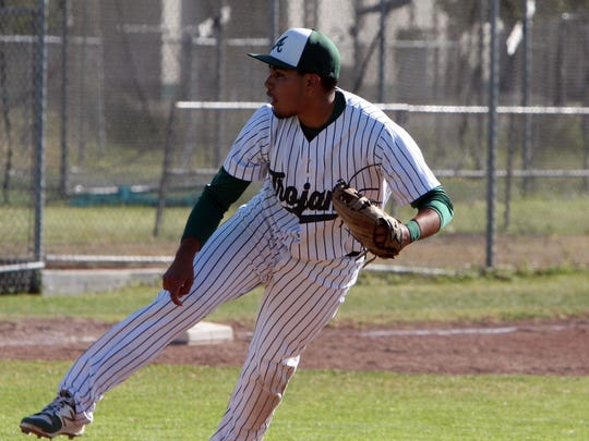 Alisal's Ruben Gomez throws a complete-game, allowing one run and six hits as the Trojans clinch their first league title since 1995 with a 5-1 victory over rival Everett Alvarez.