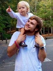 Seth Morgan and his daughter Ella enjoy a moment together.
