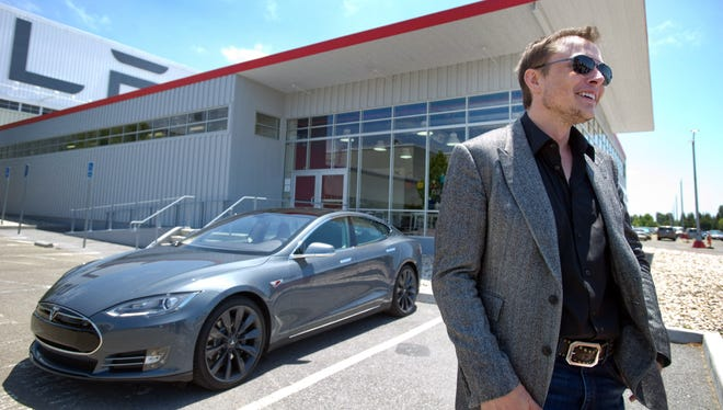 Elon Musk CEO of Tesla with a new Model S  car outside the Tesla customer deliver area at the Tesla Fremont, Calif., factory