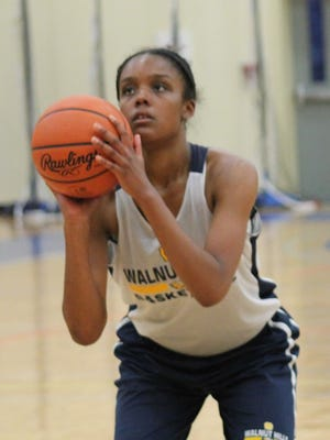 Amber Wilks of Walnut Hills shoots a free throw in the Walnut Hills summer league last June. Wilks recently signed to play in college at La Salle.