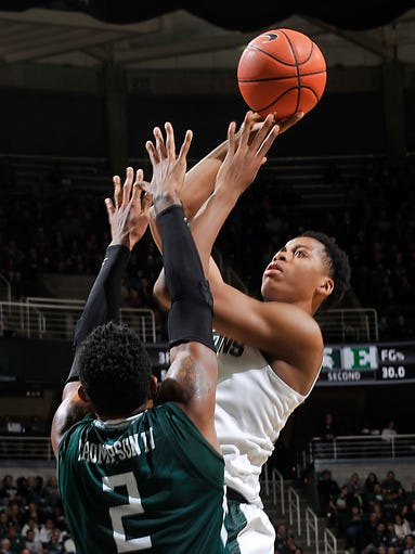 MSU's Deyonta Davis scores over the top of Eastern's