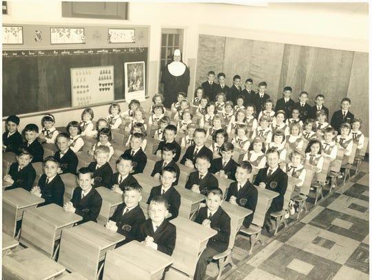 Children sit in a classroom at Queen of Heaven School in Cherry Hill.