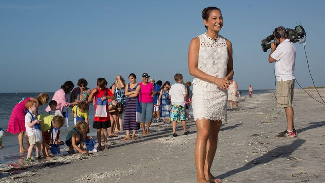 Ginger Zee,  the weather anchor for Good Morning America gives a weather update at the Sundial Resort on Sanibel Island on Monday morning.  The Good Morning America crew was in town to promote National Seashell Day.
