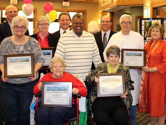 Left to right in front are Edna Sandrock and Judy Hill. In the middle are Donna Hamann, Johnny Hill, and Don and Rosi Stephens.  In back are Ottawa County Commissioner Jim Sass, Pastor Margaret Mills, Commissioner Mark Stahl and  Commissioner Mark Coppler.