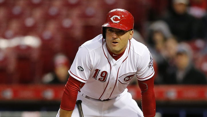 Reds first baseman Joey Votto takes a breath between