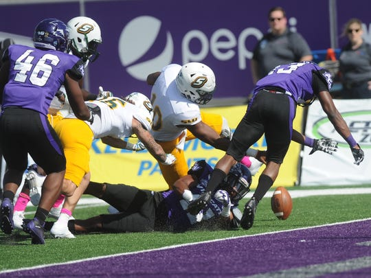 Southeastern Louisiana quarterback Lorenzo Nunez (10) fumbles the ball near the goal line. Juwan Dickey recovered the ball in the end zone for the game's first TD to give the Lions a 7-0 lead over ACU. Southeastern won the game 56-21 on Saturday, Oct. 21, 2017 at Wildcat Stadium.
