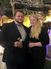 Alexander Pinczowski and his fiance Cameron Cain in Greece this year. Pinczowski has been identified as a victim of terrorist bombings in Brussels.