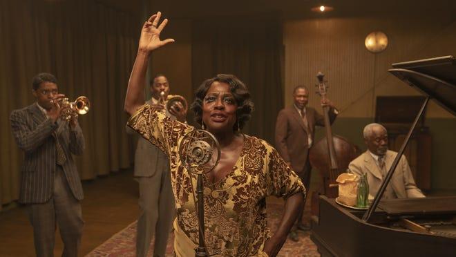 "Chadwick Boseman, left, Colman Domingo, Viola Davis, Michael Potts and Glynn Turman appear in ""Ma Rainey's Black Bottom."""