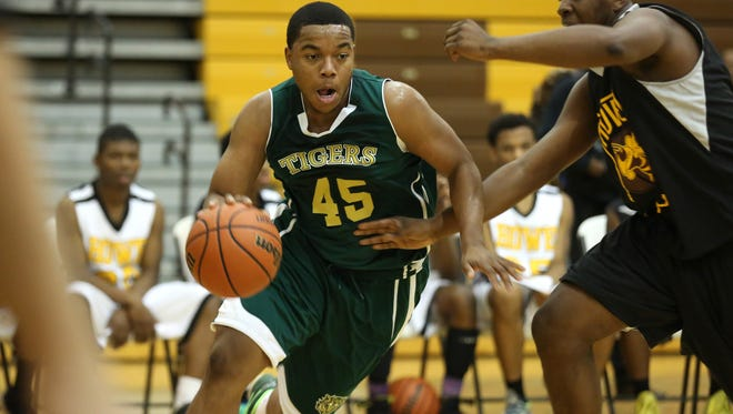Crispus Attucks' Darrell Hutchison moves to the basket during a scrimmage against Howe Friday November 21, 2014.