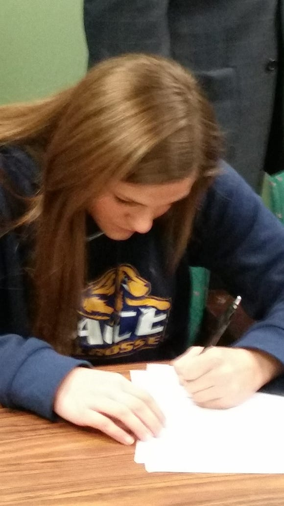 Brewster girls lacrosse player Mary Kate Lonegan signs her national letter of intent with Pace University at Brewster High School on Thursday, April 14th, 2016.