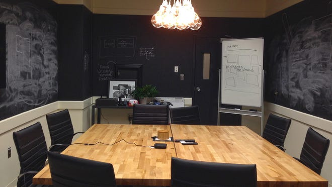 At Fairpoint Innovation Center, each tenant pays $100 a month for co-working space that offers a variety of settings, including a meeting room with blackboards for walls.