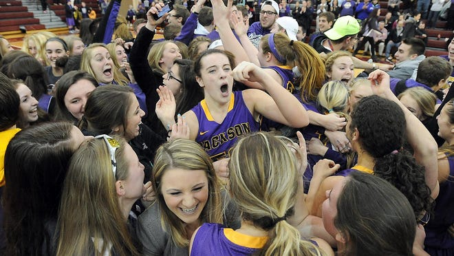 Jackson's Abby Duffy (middle) is surrounded by teammates and classmates as the Polar Bears celebrate their 2015 district title.