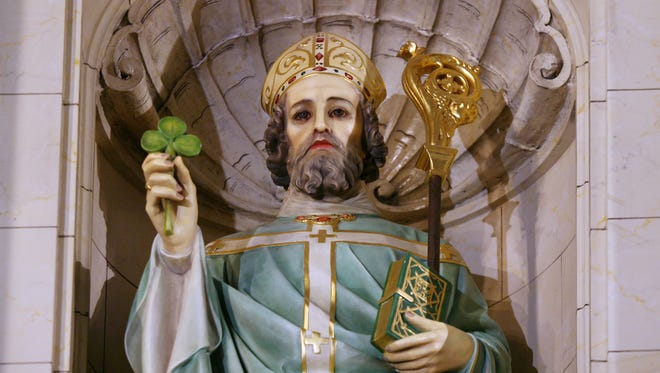 A statue of St. Patrick stands at the front of the sanctuary in St. Patrick Catholic Church in Indianapolis.