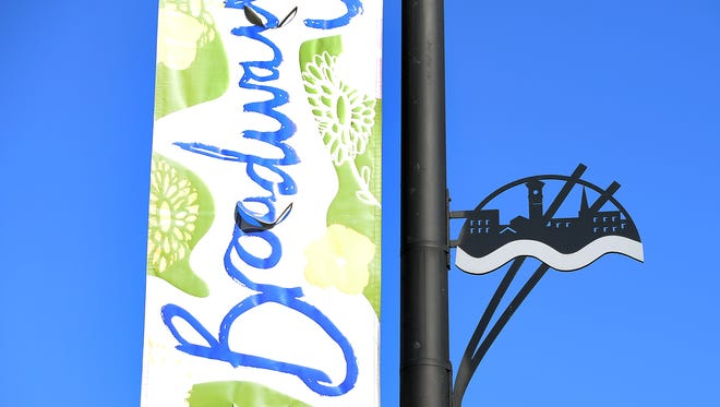 Broadway District signage on a street light pole on Broadway in Green Bay October 2, 2015.