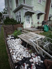 A hoarding situation that created a powerful odor for neighbors led to Palmyra police intervening on South Harrison Street. A resident, a six-year-old child, 27 Pomeranians, and an African Grey Parrot were removed from the house.