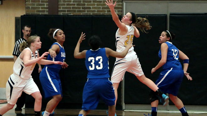 Hartland's Lexey Tobel pulls in a rebound Thursday. During a timeout, teammate Ryann Laier, far left, told Tobel she needed to score more, which impressed Hartland coach Don Palmer.