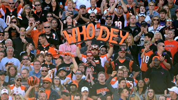 Cincinnati Bengals fans holds a sign in the stands