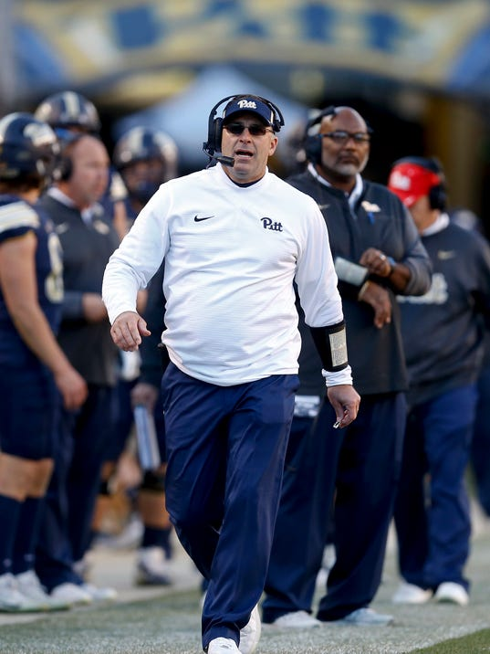 FILE - In this Nov. 24, 2017, file photo, Pittsburgh head coach Pat Narduzzi works the sideline during an NCAA college football game against Miami in Pittsburgh. Pittsburgh has signed Narduzzi to a new contract that will keep him with the Panthers through the 2024 season, the school announced Wednesday, Dec. 6, 2017. Financial details were not disclosed. (AP Photo/Keith Srakocic, File)