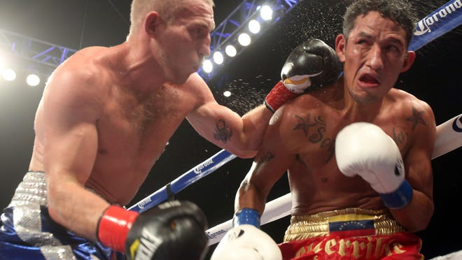 Russian Dmitry Mikhaylenko lands hard shots on Johan Perez of Venezuela. Mikhaylenko defeated Perez on a stoppage on the eighth round and is the new NABA Welterweight Champion.