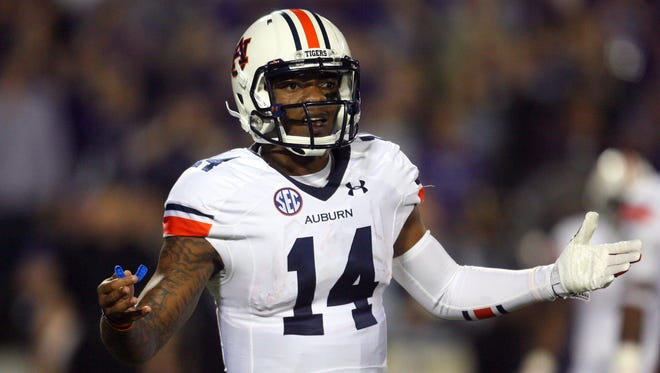 Auburn quarterback Nick Marshall was 17-for-31 for 231 yards with two touchdowns and an interception against Kansas State.