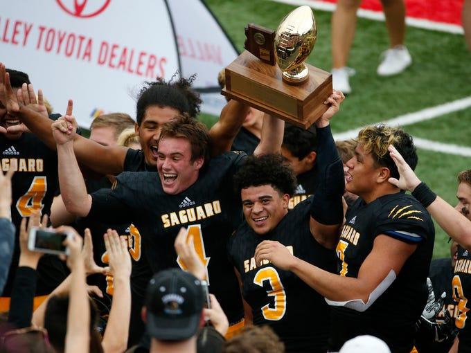 Saguaro celebrates winning the 4A high school football