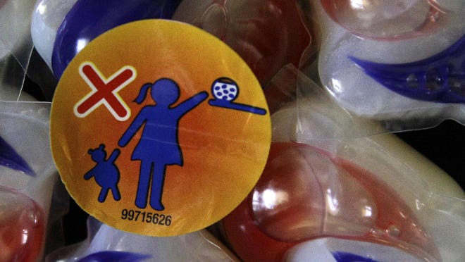 """A warning label is attached to a package of Tide laundry detergent packets in Houston. Procter & Gamble says it's working to stop the """"Tide Pod challenge,"""" a social media-fueled trend in which teenagers eat single-load laundry detergent packets."""