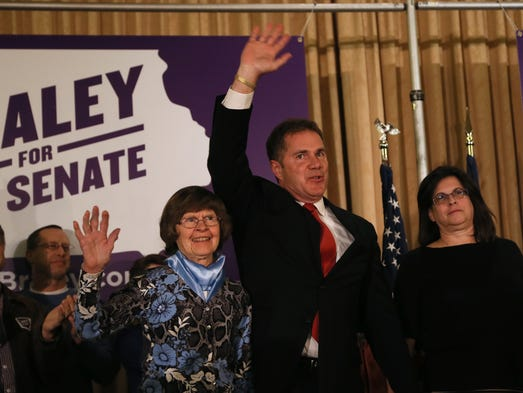 Bruce Braley greets the audience with his mother Marcia