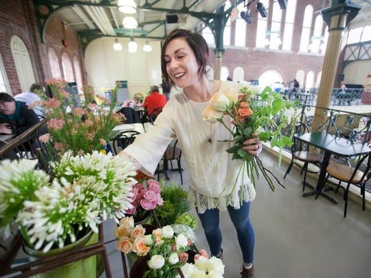 Megan Connelly began her floral design business last summer and opened a flower stand last month at City Market. Between taking care of the businesses and being mother to a 4-year-old, she typically has a pretty full day.