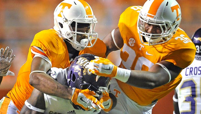 Tennessee's Jauan Jennings and Gavin Bryant (36) team up to tackle Western Carolina's Detrez Newsom (21) on Sept. 19, 2015.