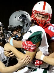 West Salem's Simon Thompson (1) is taken down by South