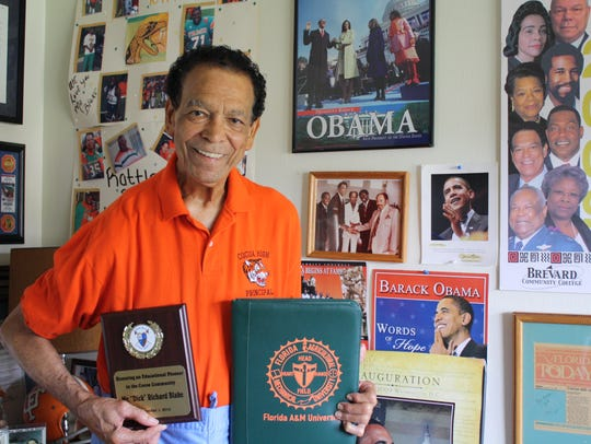 "Richard ""Dick"" Blake, Brevard County's first African-American principal, shows off memorabilia in his home in 2016. Blake served as principal at Cocoa High School from 1979 to 2001."