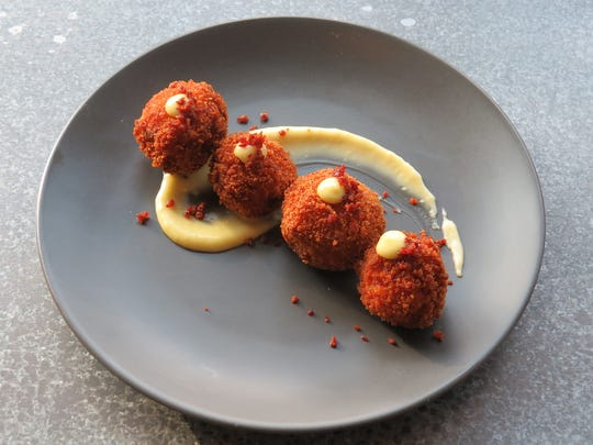 Jamon croquetas are served at Gasolina Tapas at The