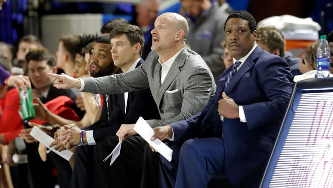 Andy Kennedy (center) realizes it's a combination of issues that have plagued Ole Miss during its three-game slide.