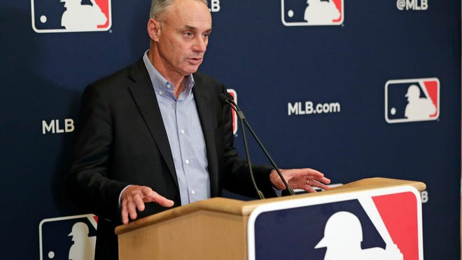 "In this Feb. 6, 2020, file photo, Baseball Commissioner Rob Manfred answers questions at a press conference during baseball owners meetings in Orlando, Fla. Manfred tells The Associated Press that the commissioner's office, teams and the players' association ""owe it to our fans to be better than we've been the last three months."""