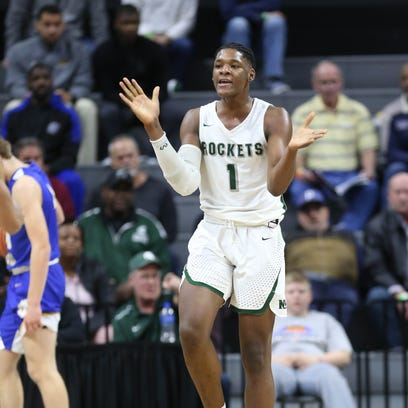 New Haven's Romeo Weems claps during the first quarter